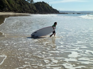 Young surfer going out